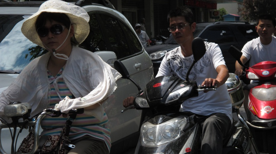 electric scooter riders close to camera