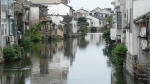 Houses line a calm canal in Suzhou