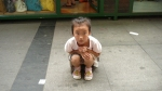 a young girls crouches toward the camera